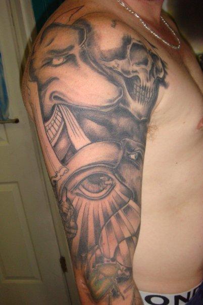 05050a4dd427e Grey Ink Anubis Tattoo On Man Half Sleeve