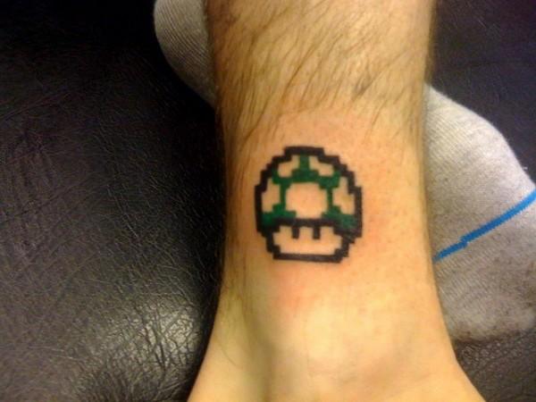 Mario Mushroom Geek Tattoo On Leg