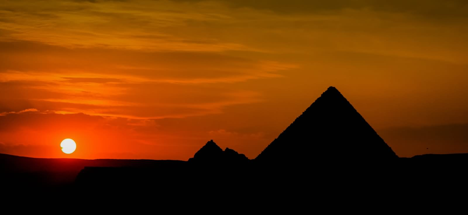 Silhouette View Of Egyptian Pyramids During Sunset