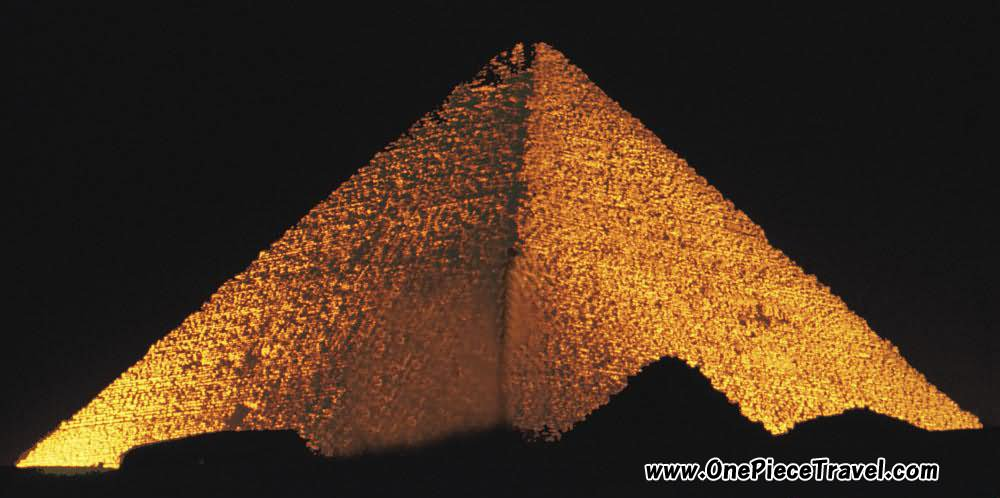 The Egyptian Pyramid Illuminated At Night