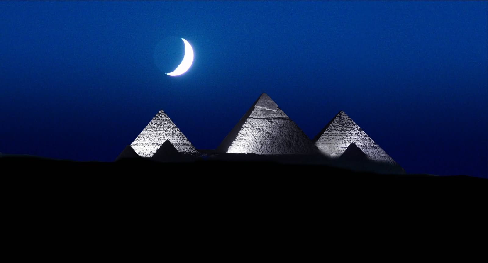 The Egyptian Pyramid With Half Moon At Night