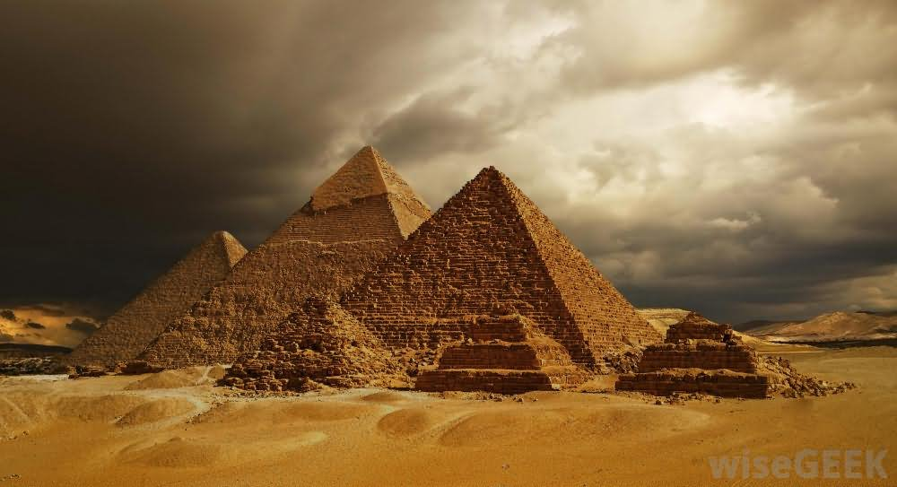 The Egyptian Pyramids With Black Clouds
