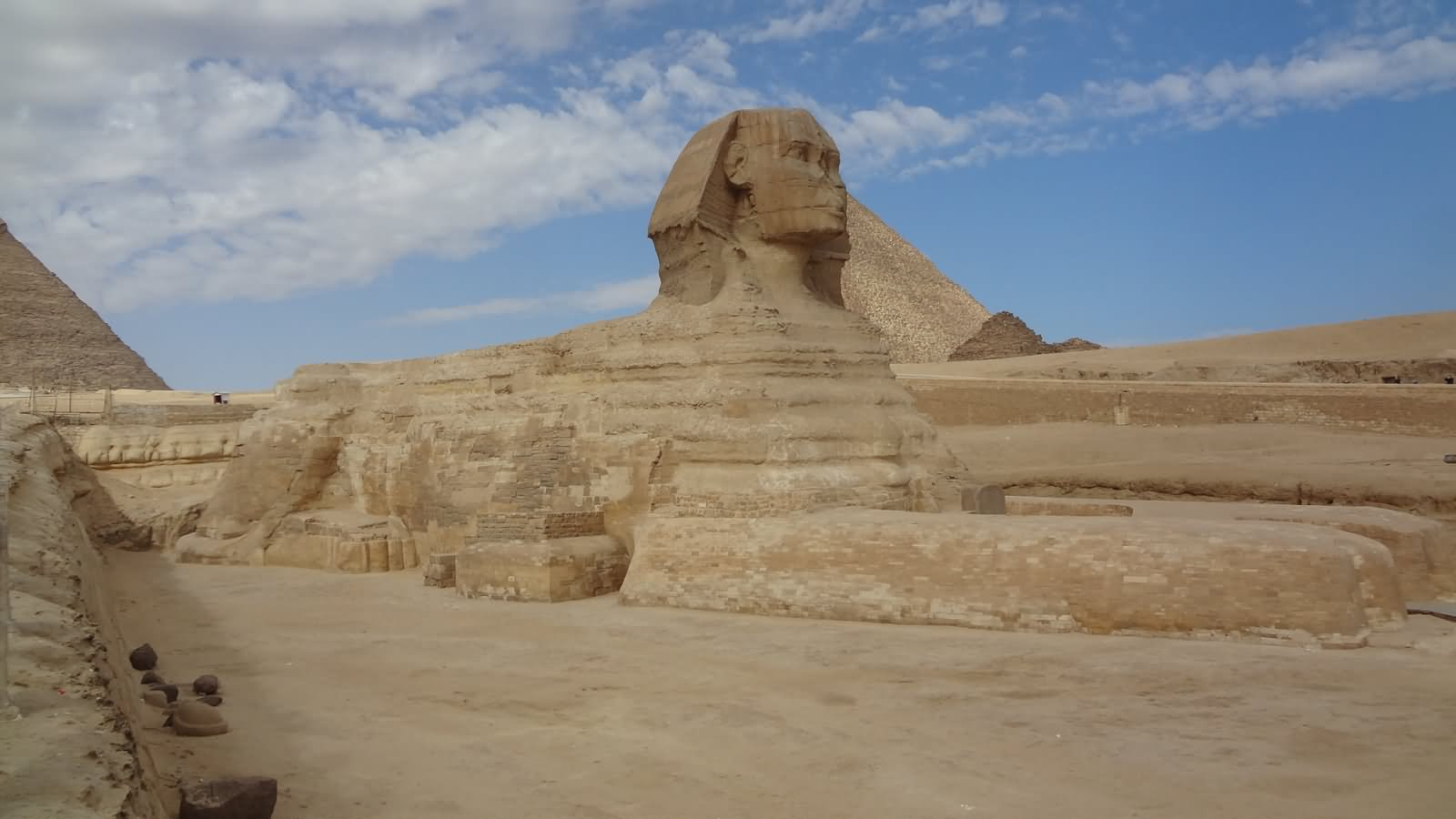 The Great Sphinx of Giza With The Pyramid Of Khufu In The Background