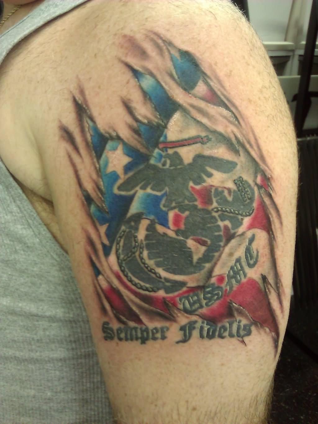 10 torn ripped skin tattoos on shoulder for Ripped skin flag tattoo