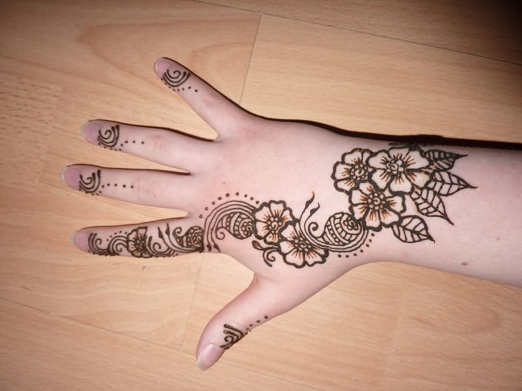 Unique henna tattoo on girl right hand for Flower tattoos on hand