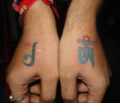 76e25f10b Awesome Jain Om Symbol Tattoo On Hand