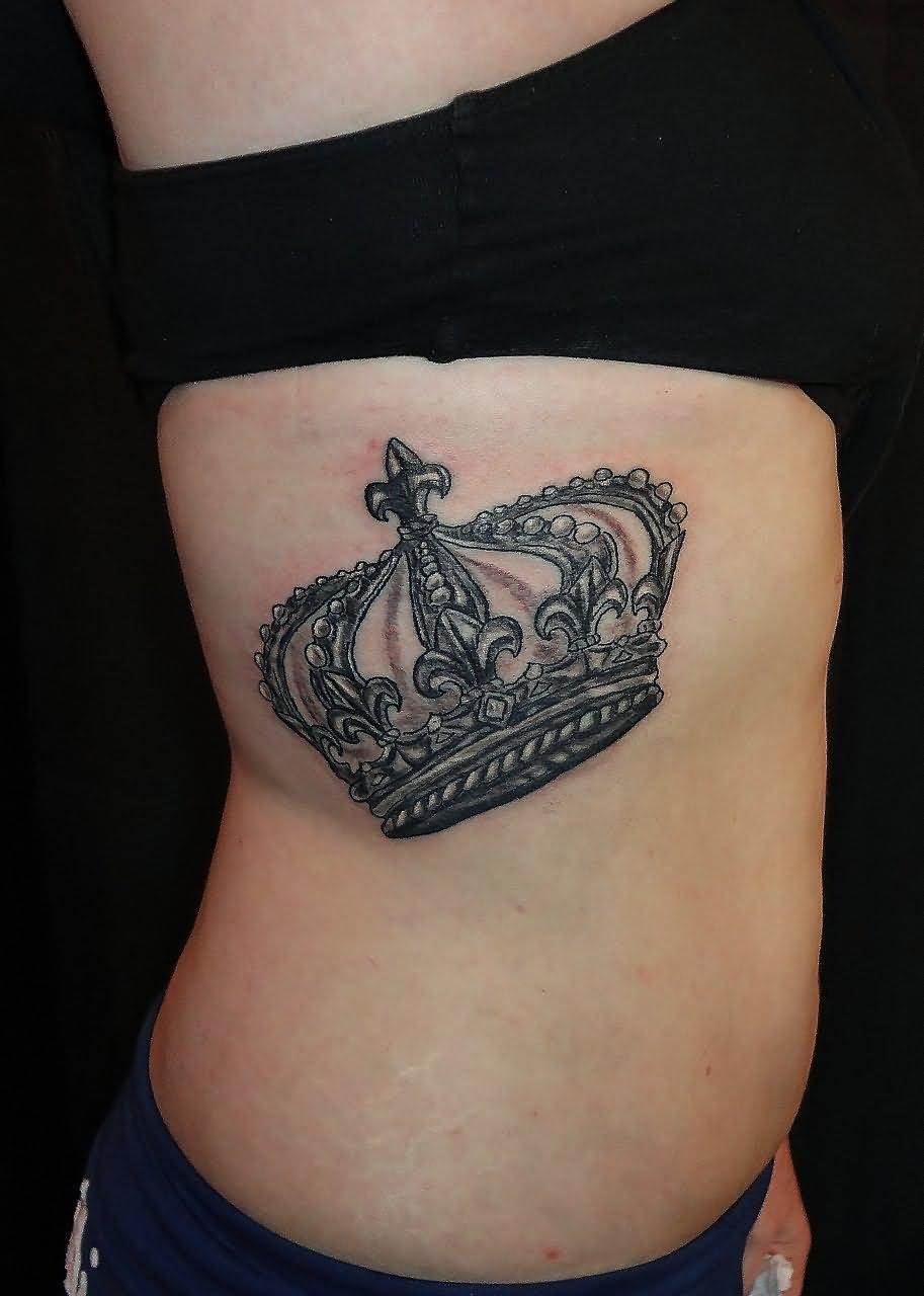 Black And Grey Queen Crown Tattoo On Girl Side Rib