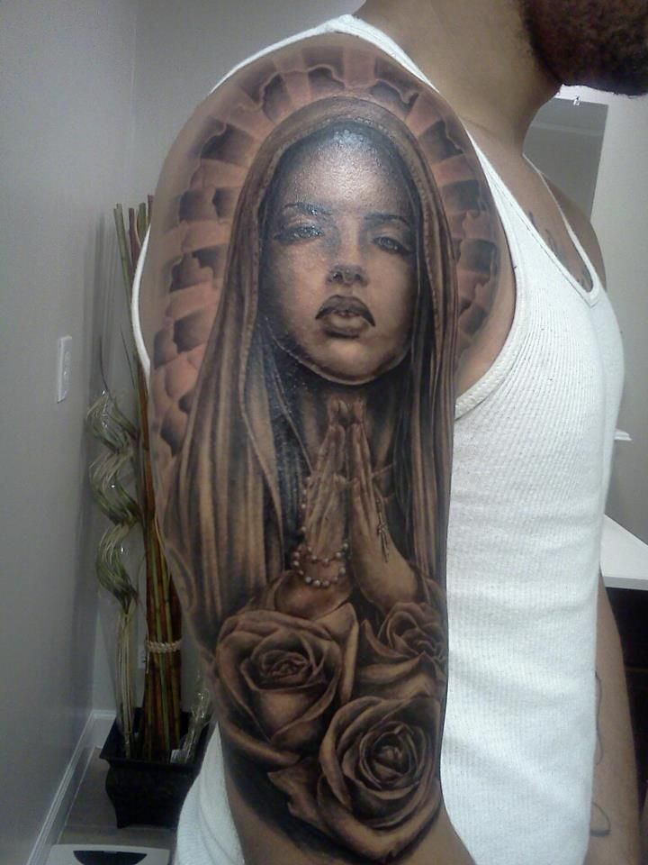Black And Grey Saint Mary With Roses Tattoo On Man Right Half Sleeve By Chris Carter