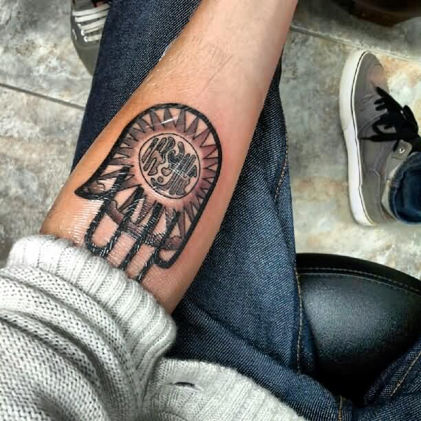 Black-Ink-Jain-Hand-Tattoo-On-Left-Forearm.jpg