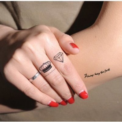 Black Queen Crown And Diamond Tattoo On Girl Finger