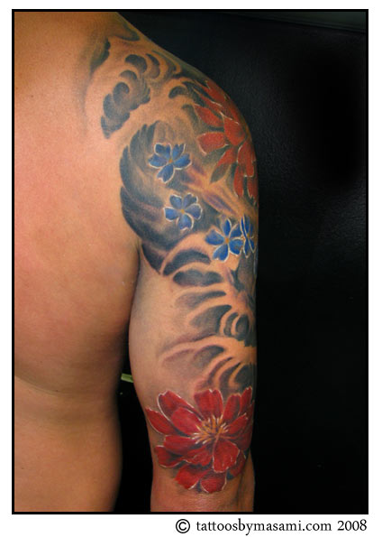 Color Flowers And Wave Tattoo On Half Sleeve