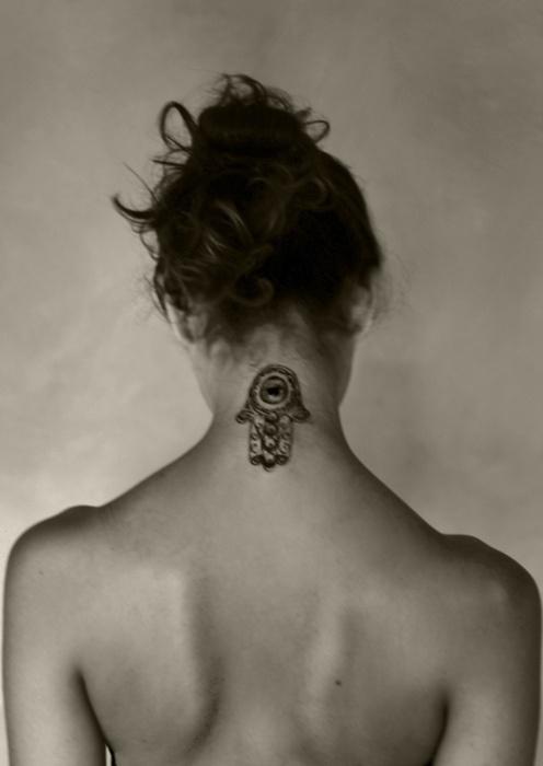 25 best jain tattoos for Girl symbol tattoos