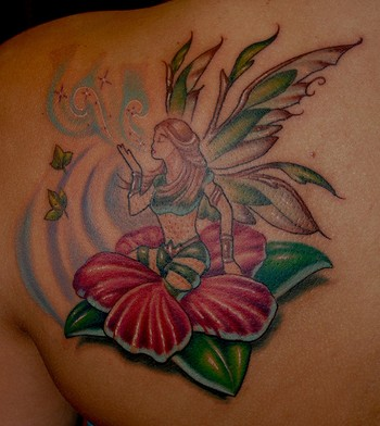 Fairy sitting on hibiscus tattoo on left back shoulder