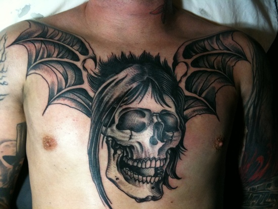 26 awesome vampire bat tattoos for Vampire skull tattoo