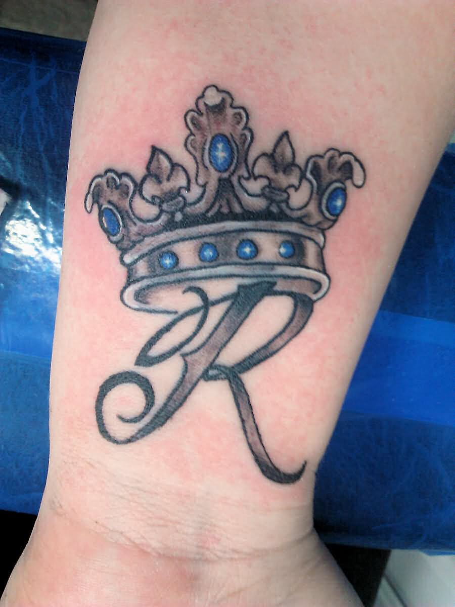 R Letter With Queen Crown Tattoo Design For Wrist