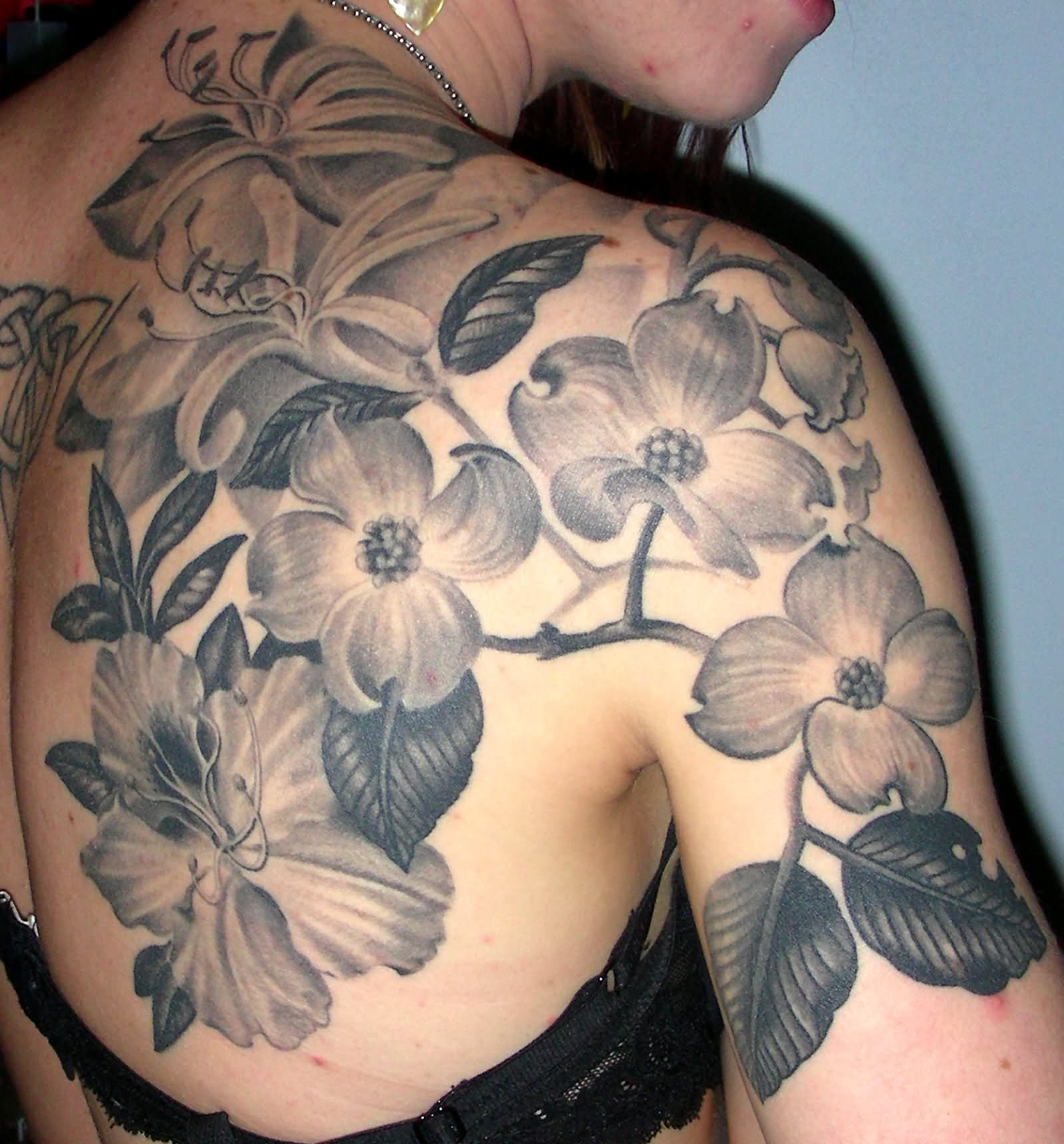 Black and white hibiscus tattoo on girl right back shoulder