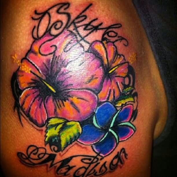 Colored hibiscus tattoo on right shoulder