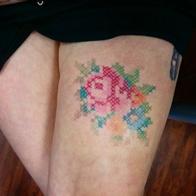 Colorful Cross Stitch Flowers Tattoo On Thigh