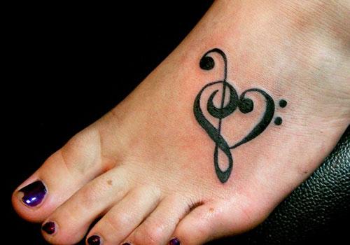 21 amazing symbol tattoos for Treble bass heart tattoo