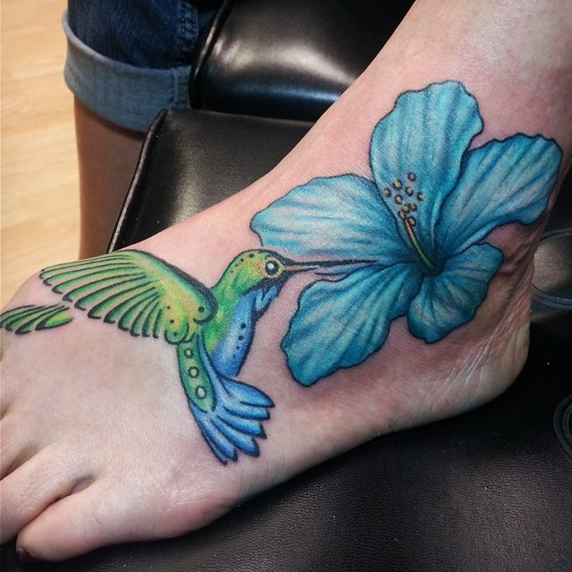 Hummingbird And Blue Hibiscus Flower Tattoo On Foot