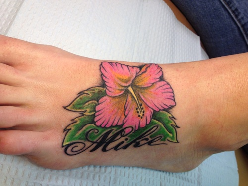 Mike name and hibiscus tattoo on left foot