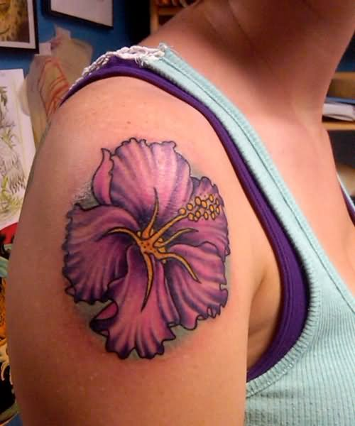 Purple hibiscus tattoo on girl right shoulder