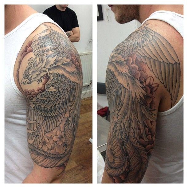 e00024d8707a6 Grey Ink Flying Phoenix Tattoo On Man Left Half Sleeve
