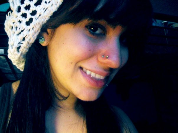 Smiling Girl With Double Nose Piercing By Yummygermsstock