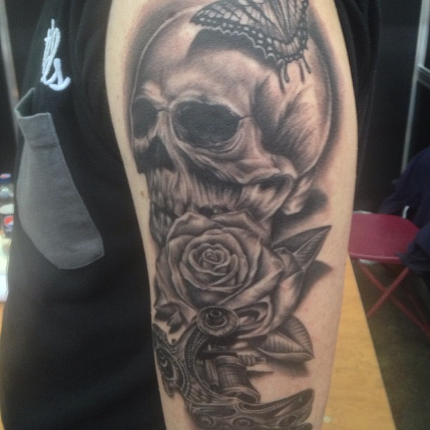 66749efaf1bff 3D Skull With Rose Tattoo Design For Half Sleeve