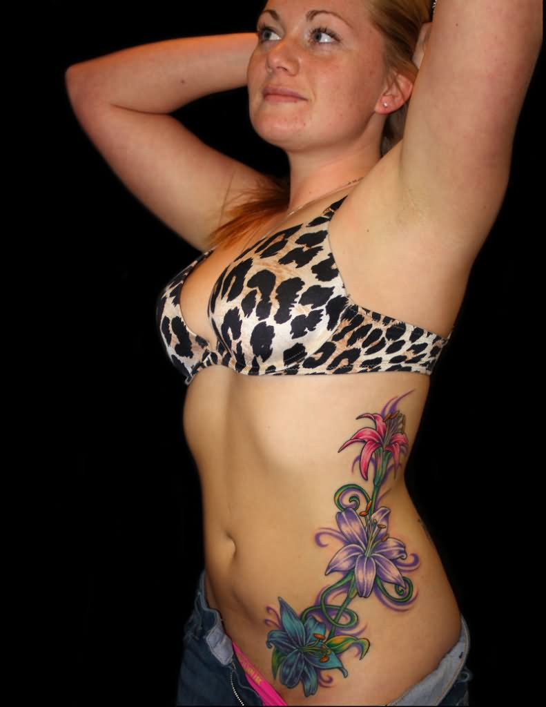 1cba7ff64 Amazing Colorful Flowers Tattoo On Girl Left Side Rib