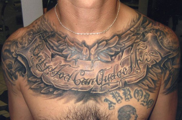 Black and grey banner tattoo on man chest for Black and grey chest tattoos