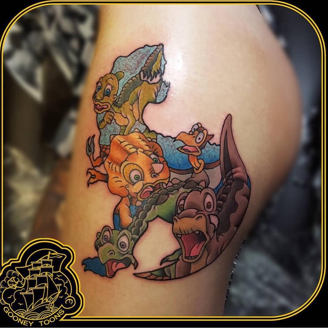 Left half sleeve dinosaur tattoo idea for Small cartoon tattoo designs