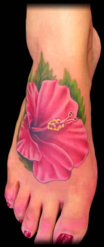 foto de Pink Ink Hibiscus Flower Tattoo On Girl Foot