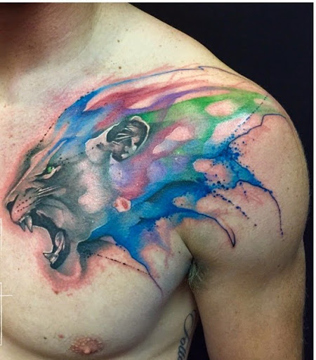 Watercolor Lion Face Tattoo On Man Front Shoulder