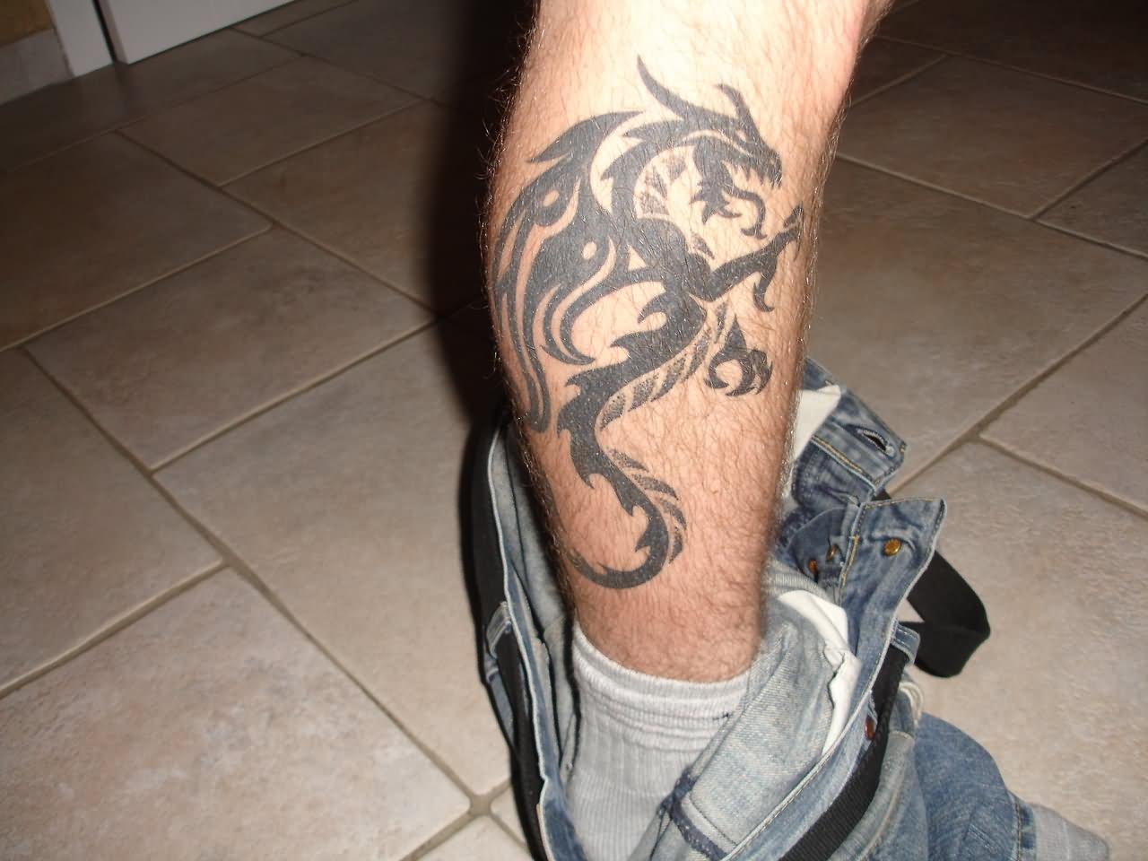 Black Tribal Dragon Tattoo On Right Leg