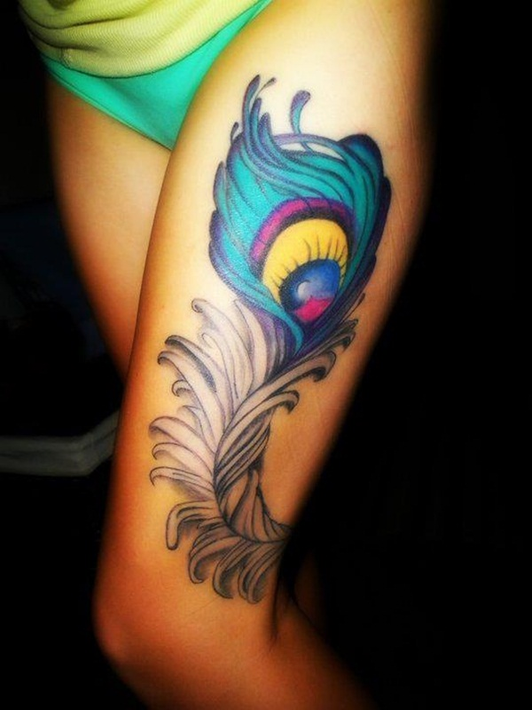 Colorful peacock feather tattoo on upper leg for Feather tattoo on thigh