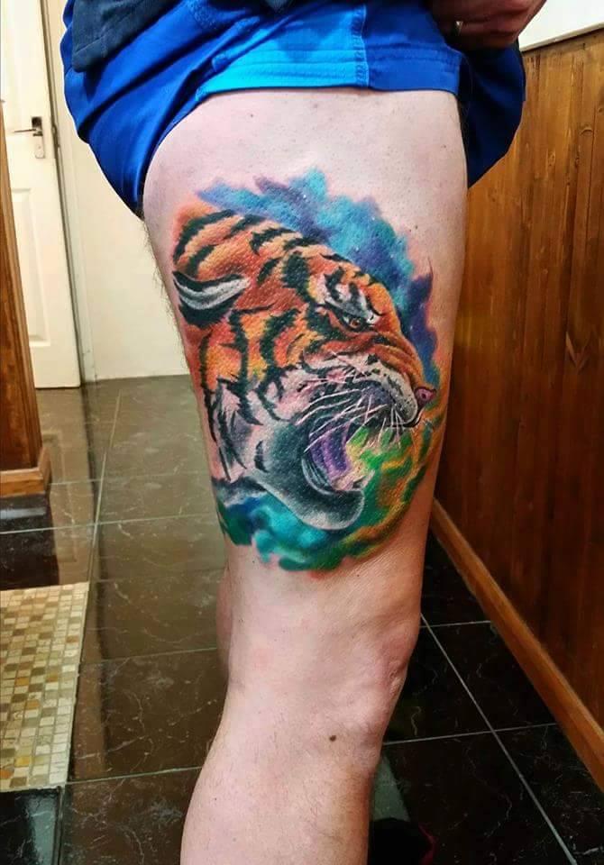 Beautiful Color Tiger Head Tattoo On Thigh By Beyur Kaptan