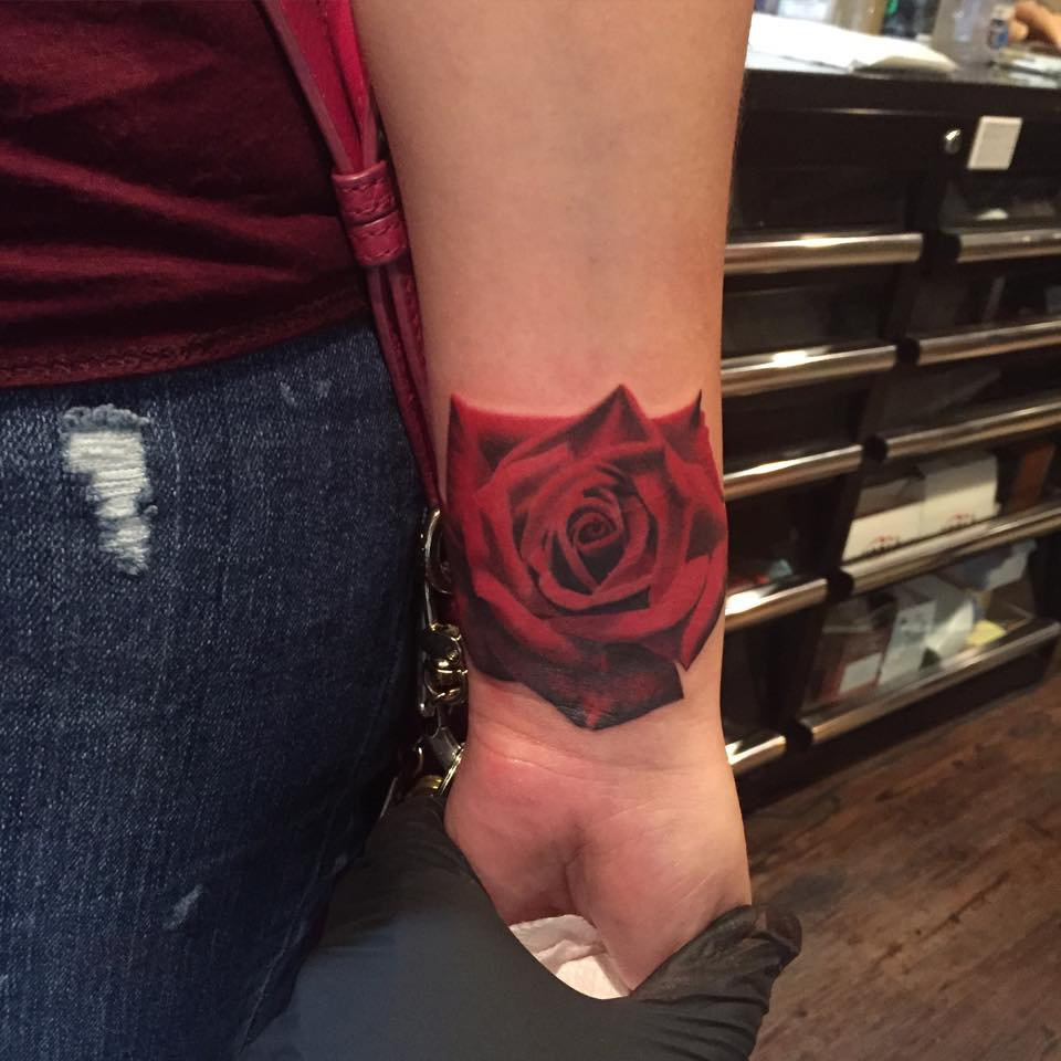 beautiful red rose tattoo on wrist by francisco sanchez. Black Bedroom Furniture Sets. Home Design Ideas