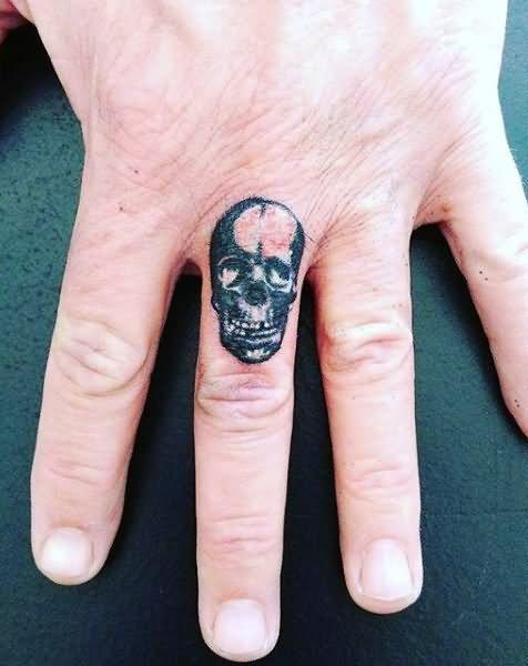 black ink skull tattoo on finger. Black Bedroom Furniture Sets. Home Design Ideas