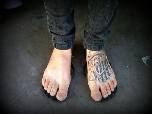 741b37e23 Cool Ripped Skin Skeleton Foot Tattoo On Man Left Foot