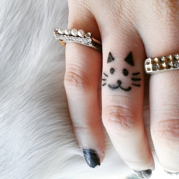 cute small tiger face tattoo on middle finger. Black Bedroom Furniture Sets. Home Design Ideas