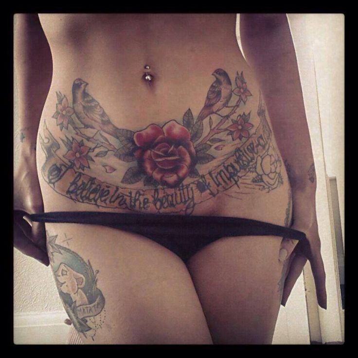 6f716e97a Flowers With Birds And Banner Tattoo On Girl Stomach