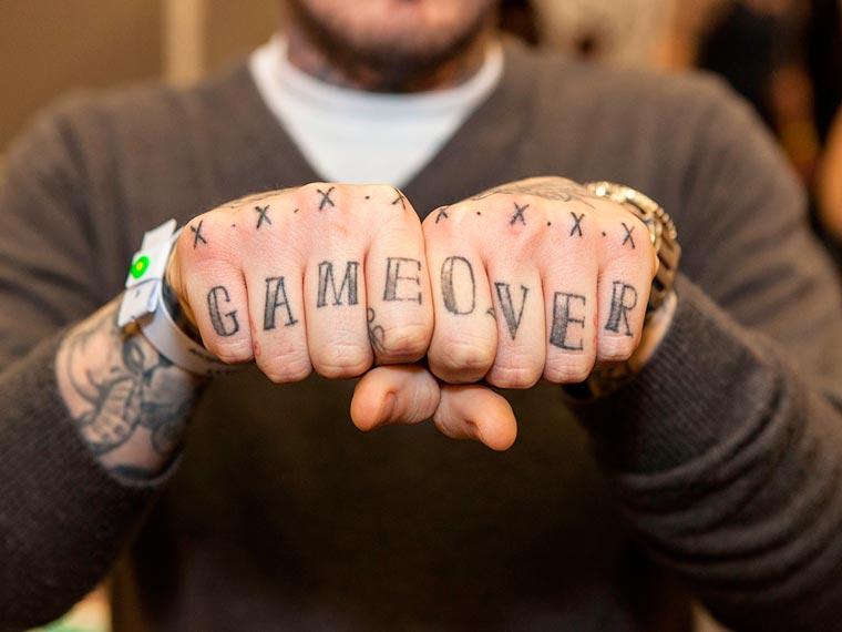 grey ink game over tattoo on hands. Black Bedroom Furniture Sets. Home Design Ideas