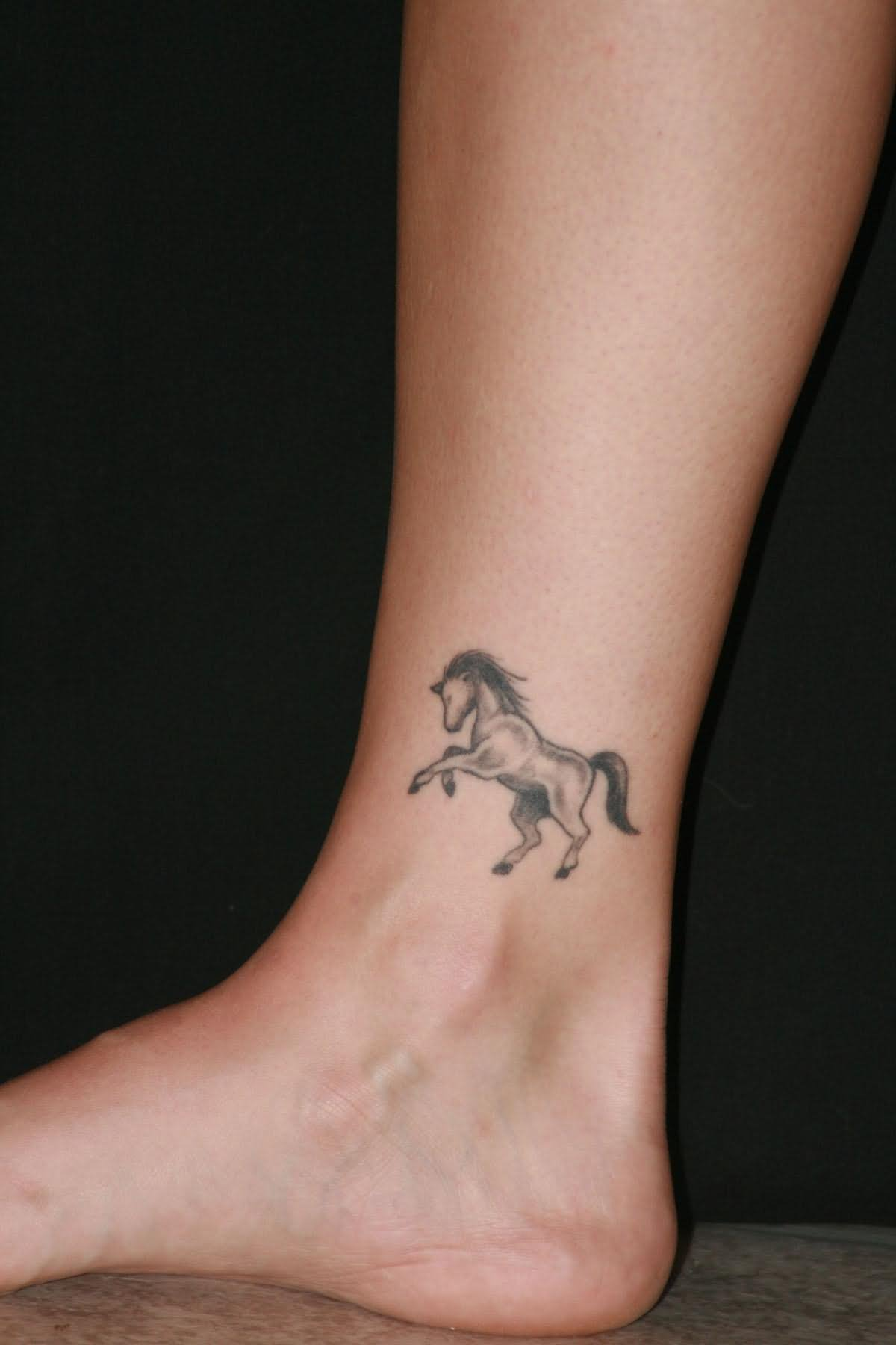 Grey Ink Horse Tattoo On Ankle