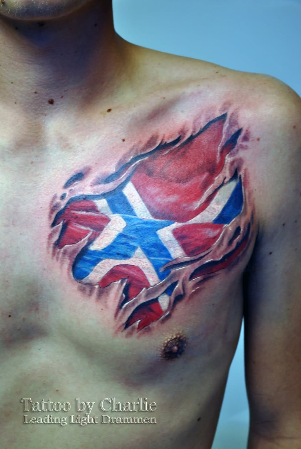 Name canadian flag ripping through skin tattoo designjpg pictures - Ripped Skin Canada Flag Tattoo Design Ripped Skin Norsk Flag Tattoo On Man Left Front Shoulder