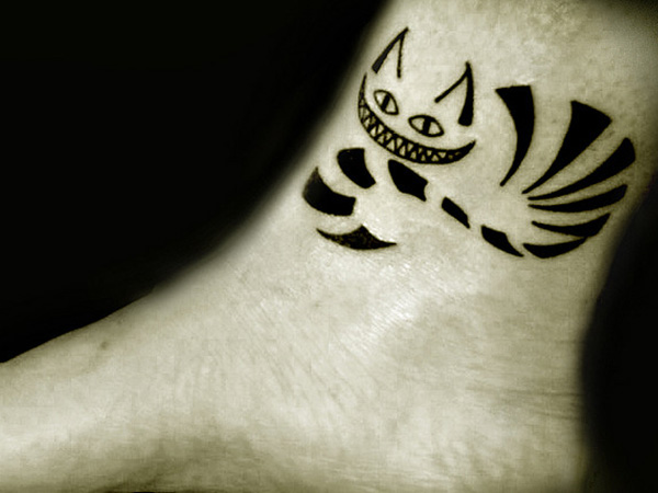 Black Ink Cheshire Cat Tattoo On Ankle
