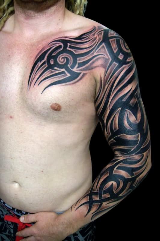 b5a181b33 Black Ink Tribal Design Tattoo On Man Left Full Sleeve