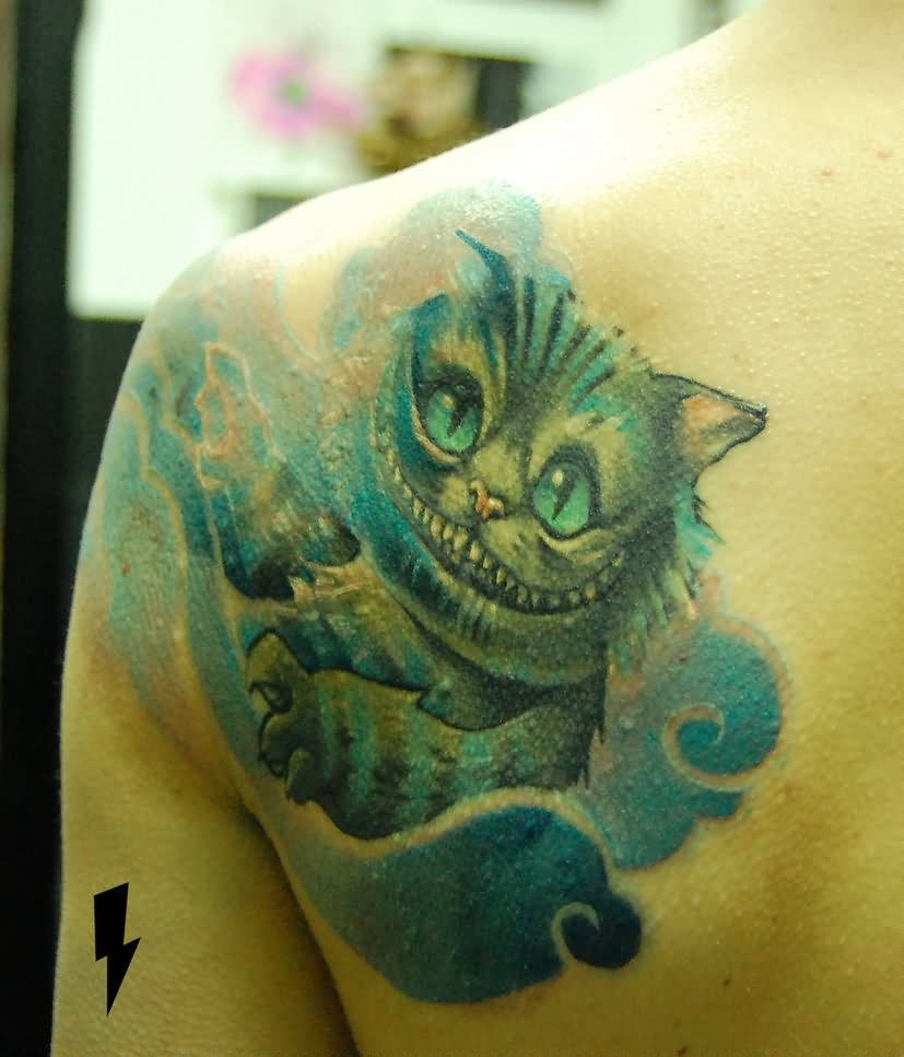 Cheshire Cat Tattoo On Left Back Shoulder by Wond3rfullywick3d