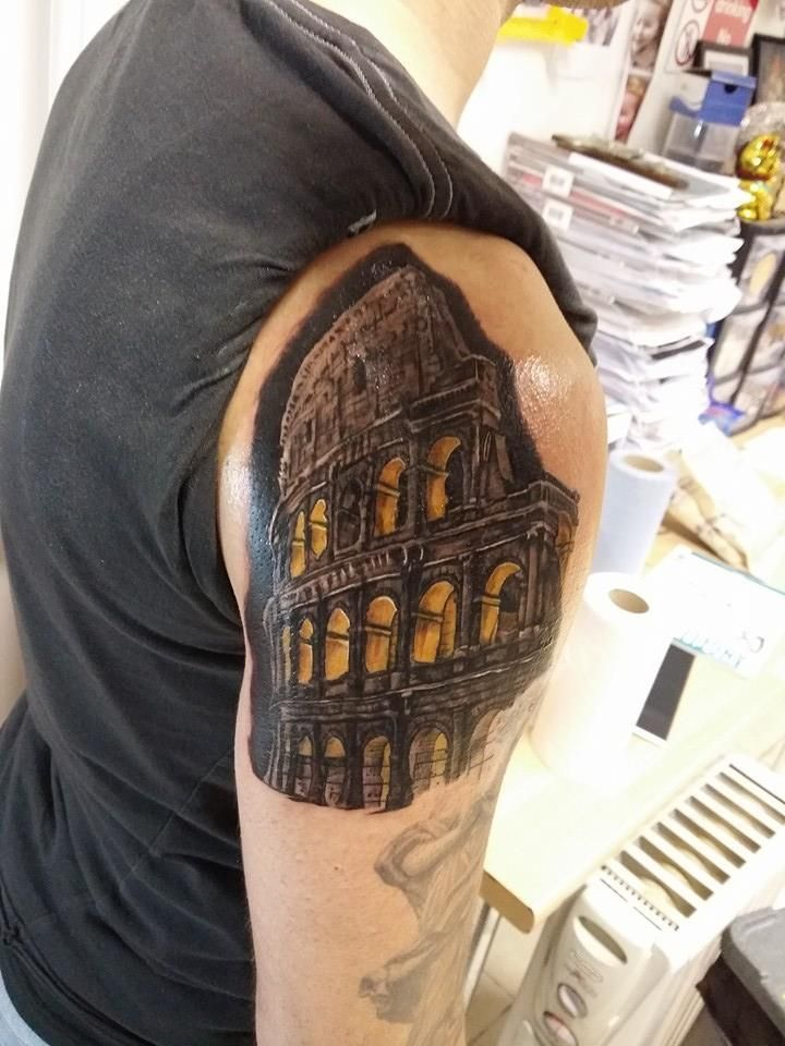 colosseum tattoo on right shoulder