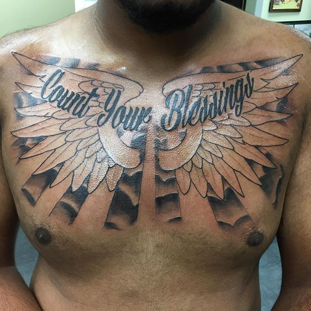 ddf52da62 Count Your Blessings - Wings And Cloud Tattoo On Man Chest